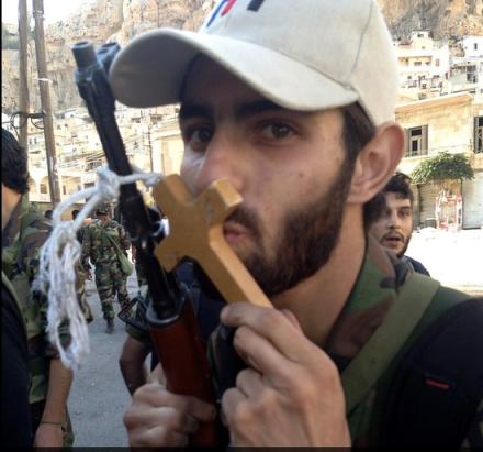 Cristiano en Malula, luchando junto a las tropas del régimen.