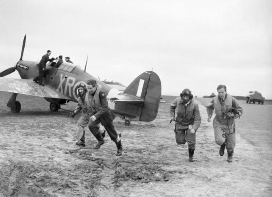 american_pilots_of_no_71_27eagle27_squadron_rush_to_their_hawker_hurricanes_at_kirton-in-lindsey2c_17_march_1941-_ch2401